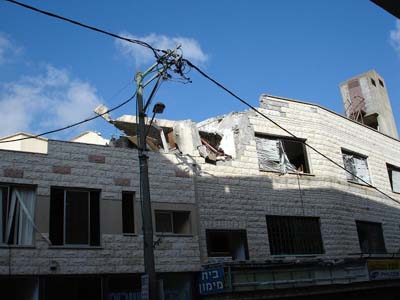 Building Severely Damaged on Rechov Aliyah Bet in the first Katyusha Rocket Attack on Tzfat--resulted in one fatality.  Click to enlarge and see Ahalevy's whole slide show.