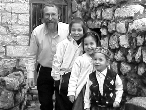 Chayim, David, Hannah and Aharon Zaklad in front of Chayim's Office.  Click to Enlarge.